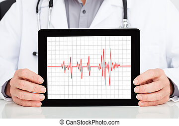Doctor Showing Heartbeat On Digital Tablet
