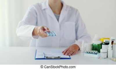 doctor showing pack of pills at hospital - medicine,...