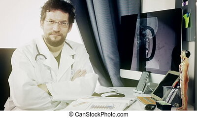 doctor sitting at desk smiling