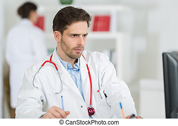 doctor sitting on the desk in office