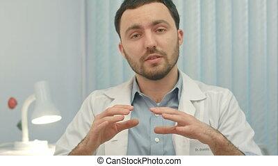 Doctor speaks on Camera at hospital