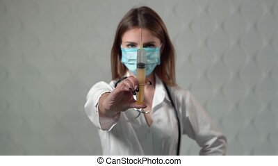 Doctor Squirting Liquid - Female caucasian doctor squirting...