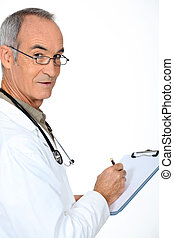 Doctor stood with clipboard
