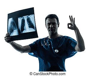 doctor surgeon radiologist gesturing okay examining lung torso