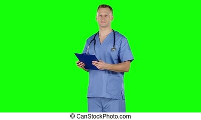 Doctor takes notes. Green screen