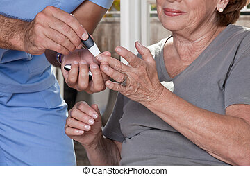 Doctor taking a Blood Sample - Doctor taking a blood sample...