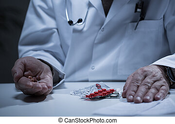 Doctor taking a lot of drugs