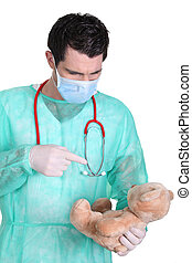 Doctor taking care of teddy bear