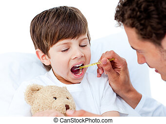 Doctor taking little boy\'s temperature