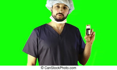 doctor talking about medication in pill bottle on the green...
