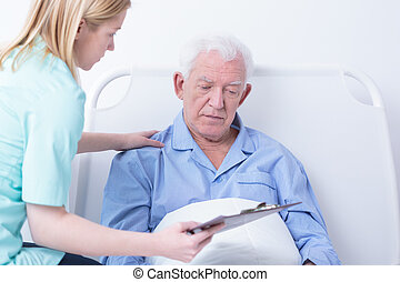 Doctor talking patient about cancer