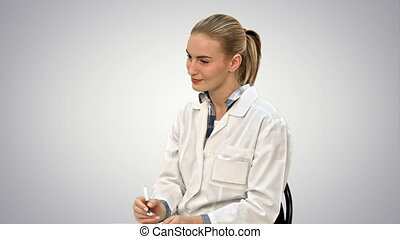 Doctor talking to a patient, giving consultation sitting on white background.