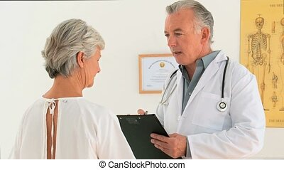 Doctor talking to his patient