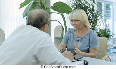Doctor talking to patient at a reception