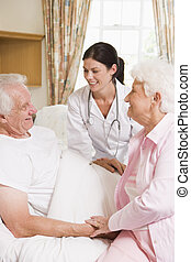 Doctor Talking To Senior Man And His Wife