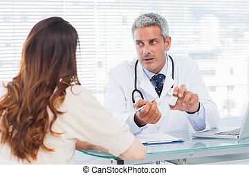 Doctor talking with his patient seriously