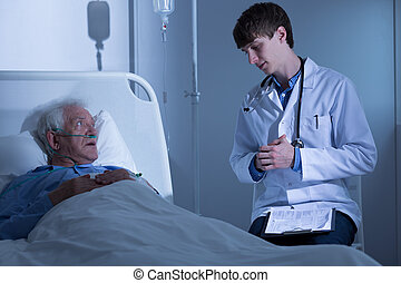 Doctor talking with ill man