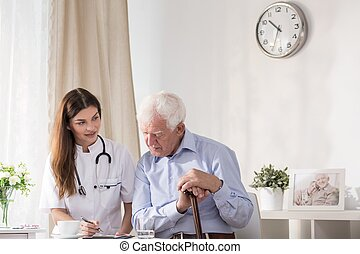 Doctor talking with senior man