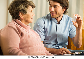 Doctor talking with senior woman