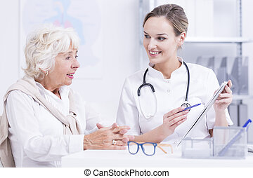Doctor  talking with the senior woman