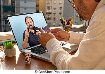 doctor talks to his patient via telemedicine during the coronavirus pandemic at his front-to-window residence
