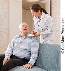 doctor talks with  senior  patient