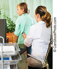 Doctor touching  behind of  teenager  patient