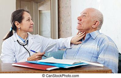 Doctor touching neck of senior man