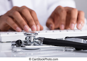 Doctor Typing On Computer Keyboard