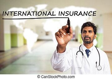 Doctor underlining international insurance on screen