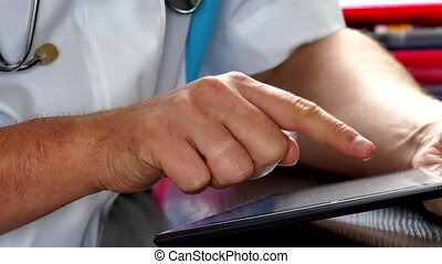 Doctor using digital tablet at the hospital