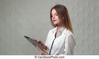 Doctor Using Tablet - Female doctor using tablet,...
