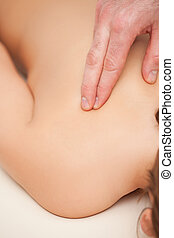 Doctor using two finger while massaging his patient
