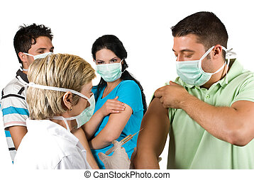 Mature woman doctor vaccinate a young guy in front of image and other waiting or did the vaccine in background, all people wearing protective mask concept of protect from ilness by vaccination or immunization
