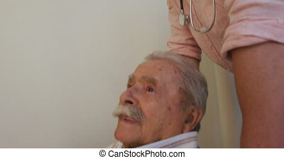 Doctor walking a senior man in a corridor of the retirement home