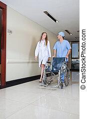 Doctor walking with male nurse