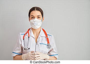 Doctor wearing facemask during coronavirus and flu outbreak...