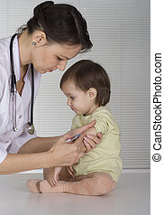 doctor with a beautiful baby