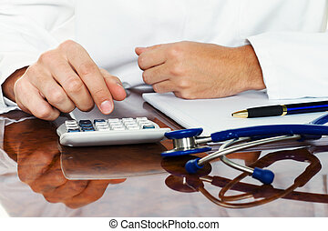 doctor with a calculator. calculation of costs and revenues...