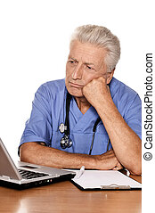 Doctor with a laptop on white background