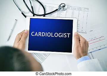 doctor with a tablet with the word cardiologist