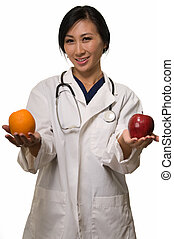 Doctor with apple and orange