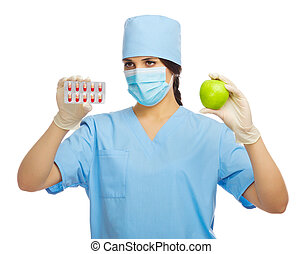 Doctor with apple and pills