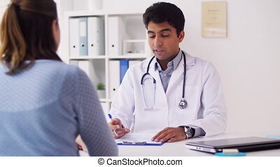 doctor with cardiogram and patient at hospital - medicine,...