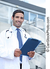 Doctor with clip-board