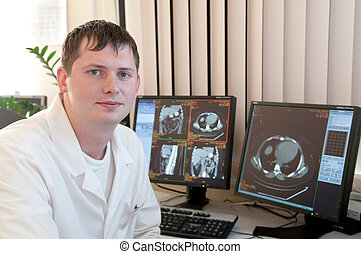 Doctor with CT scan films