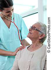 Doctor with elderly female patient