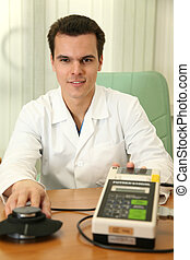 doctor with fat measurer