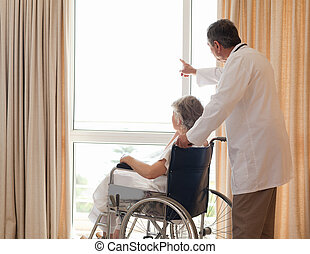 Doctor with his patient looking out the window