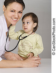 doctor with little girl